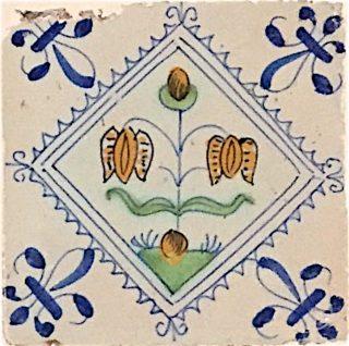Tegel met Kievitsbloemen, vertakt midden aan de stengel.